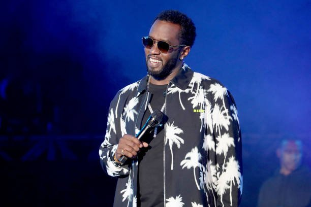 Diddy performing on stage.